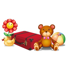 A red bag surrounded with toys vector image