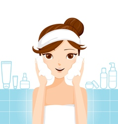 Young woman washing face with foam vector image vector image