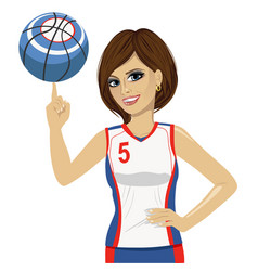 Woman spinning basketball ball with her finger vector