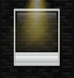 Blank photoframe on black wall vector