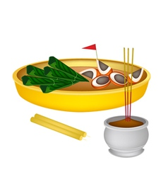 Areca nuts and betel leaves with candle and joss s vector