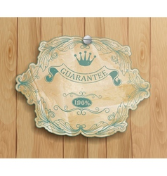 vintage label on the wooden background vector image