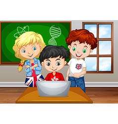 Children looking at computer in classroom vector image
