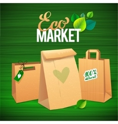 Eco market promo paper bags and leaves on green vector