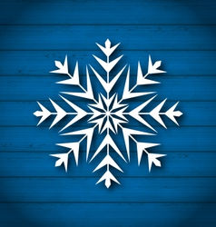 Geometric snowflake on wooden background vector image vector image