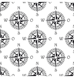 Seamless pattern of a vintage compass vector