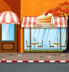 Bakery shop with tables and chairs outside vector