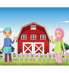 A male and a female muslim in front of a barnhouse vector