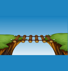 Wooden bridge between cliffs vector