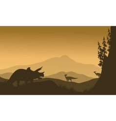 Parasaurolophus and Triceratops in hills of vector image