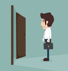 Businessman walking to opened door vector