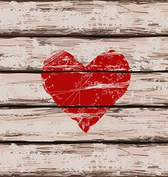 Heart symbol on wooden boards vector image