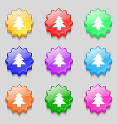 Christmas tree icon sign symbol on nine wavy vector
