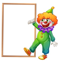 A clown pointing at the white board vector image