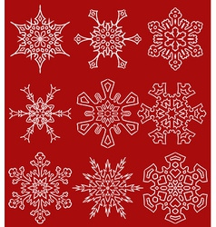Set of drawn snowflake silhouettes vector image