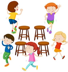 Children playing music chairs vector