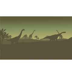 Silhouette of many brachiosaurus in hills vector