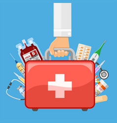 First aid kit in doctor hand vector