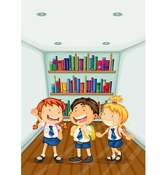Three kids wearing their school uniforms vector image vector image