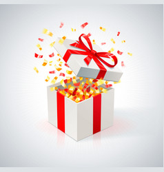 white gift box with red ribbon and golden confetti vector image