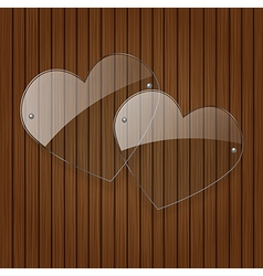 two glass hearts over wooden background vector image