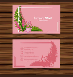 Businesscard template with flowers on pink vector