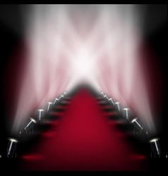 Red carpet runway with spotlights vector