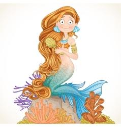 Lovely mermaid combing her long hair vector