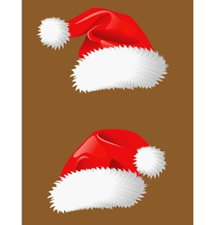 Red christmas hats of Santa Claus vector image