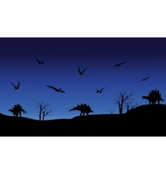 Silhouette of pterodactyl and stegosaurus vector