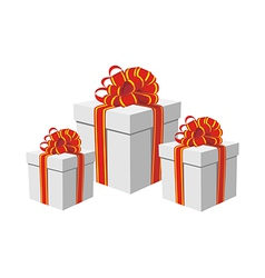 Gift boxes with red and golden ribbons vector image