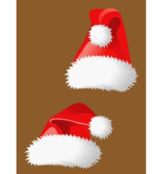 Two red christmas hats of Santa Claus vector image
