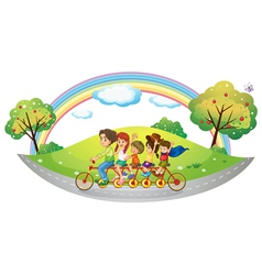 Children riding in a bicycle vector image
