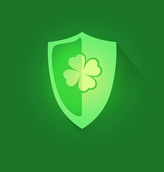 Shield with shamrock clover vector