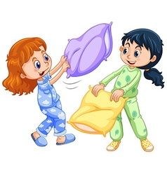 Two girls playing pillow fight at slumber party vector image