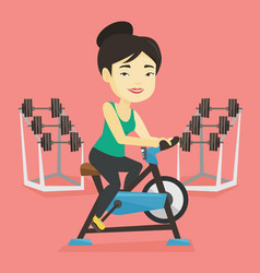 young woman riding stationary bicycle vector image