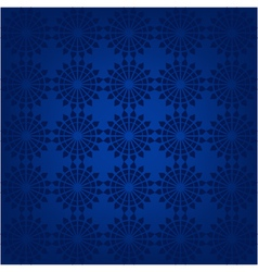 Seamless pattern with snowflakes on a blue backgro vector