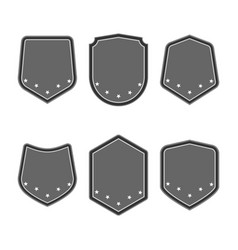 Set of black shields with stars in trendy flat vector