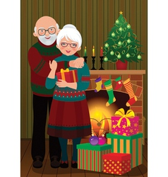 An elderly couple in the fireplace Christmas vector image