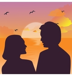 Silhouette of a couple kissing against a sunset vector image