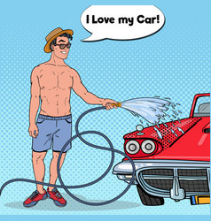 Pop art handsome man washing his classic car vector
