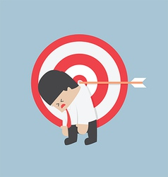 Businessman hanging on the target 380x400 vector