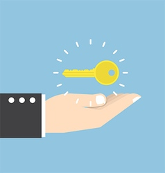 Businessman with golden key over his hand vector image