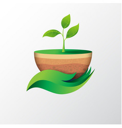 green leaf in hand shape holding sapling vector image