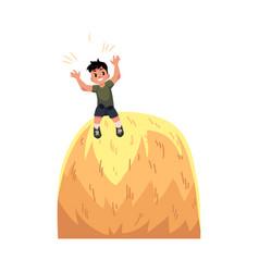 Happy teen boy sitting on top of hay stack vector