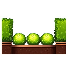 Seamless fence design with bushes vector