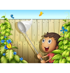 A butterfly catcher inside a yard with fence vector