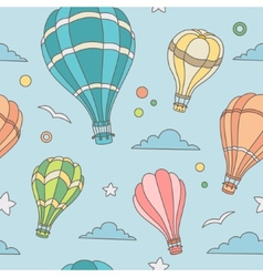 Seamless pattern of hot air balloons on the sky vector