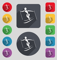 Skier icon sign a set of 12 colored buttons and a vector