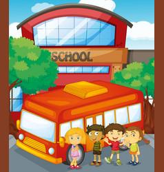 children standing by schoolbus at school vector image